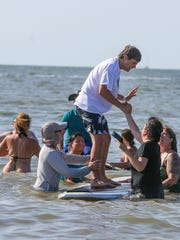 Surfers for Autism returned for their fifth annual Gulf Coast Beach Festival, and Fort Myers Beach was once again transform into an oasis of acceptance and inclusion, Saturday, October 31, 2015. Around, 200 children, young adults and their families experienced a day in the water, paddle boarding and surfing. Volunteers took the participants out for 25 minutes at a time and the reactions and the results are consistently staggering.