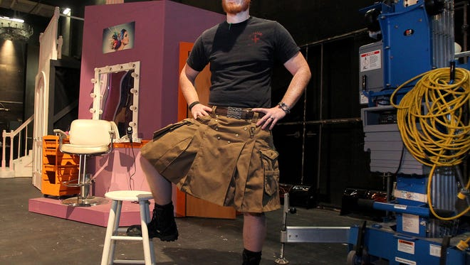 Baylor theater professor Jordan Rousseau stands near a set while wearing hit kilt which he wears once a week, on Wednesday.