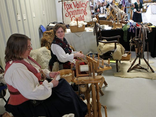 Women with the Fox Valley Spinning Guild, Mary Silver and Pam Kubale, show their spinning skills at the Echoes of the Past Historical Trade fair in this file photo. This year's event is Feb. 25 and 26.