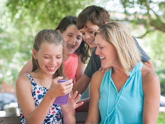 RayAnn Moseley and her family play on smartphone app