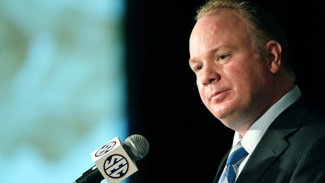 Kentucky Wildcats head coach Mark Stoops talks with reporters last year during the 2013 SEC Media Days at the Hyatt Regency.