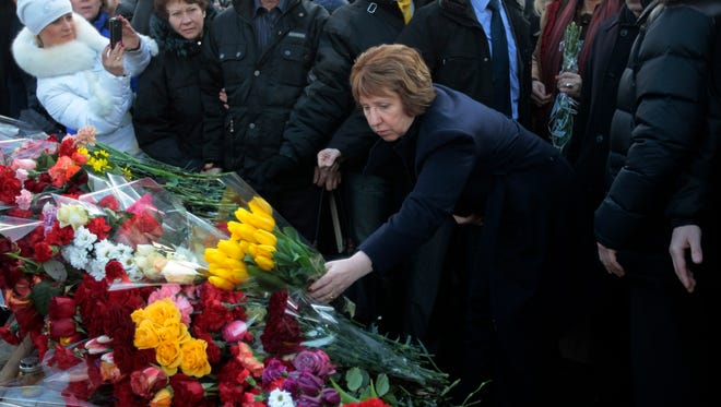 EU foreign policy chief Catherine Ashton places flowers at a memorial for the people killed in clashes with the police in central Kiev, Ukraine, on Feb. 24.