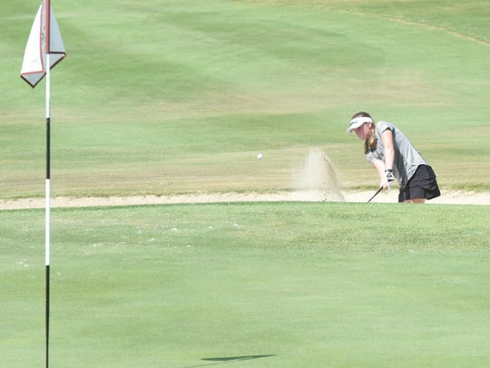 Mountain Home's Kenzie Collins hits out of the 18th