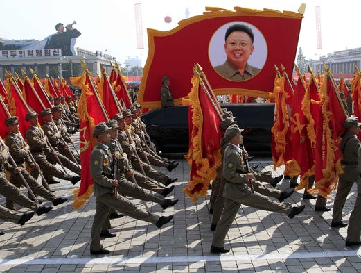 North Korean troops march past a portrait of the late leader Kim Jong Il during a military parade celebrating the 65th anniversary of the country's founding on Sept. 9 at Kim Il Sung Square in Pyongyang.