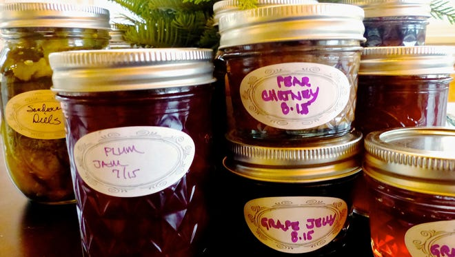 This Nov. 22, 2016 photo shows an assortment of jarred preserves, fruits and pickles in Langley, Wash., which are homegrown edibles exchanged as holiday gifts. Labels add a personal touch and in many cases include the ingredients as well as suggestions about how the foods should be used. Gardeners make good friends, especially during the holidays, as they share their homegrown harvest.