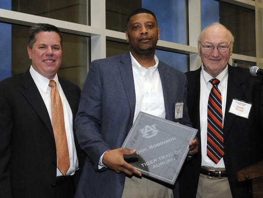 Doc Robinson, middle, was inducted into Auburn's Tiger