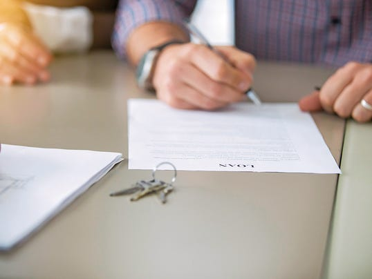 Close up of signing a loan