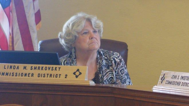 From left, Luna County Commission Chair Linda Smrkovsky and Commissioner John Sweetser listen during Thursday's regular meeting.