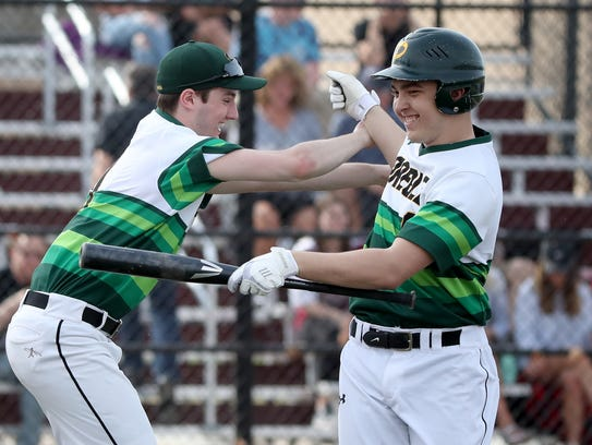 Green Bay Preble's Max Wagner is greeted by Zach Renier after hitting a solo home run against De Pere during a May 1 game.