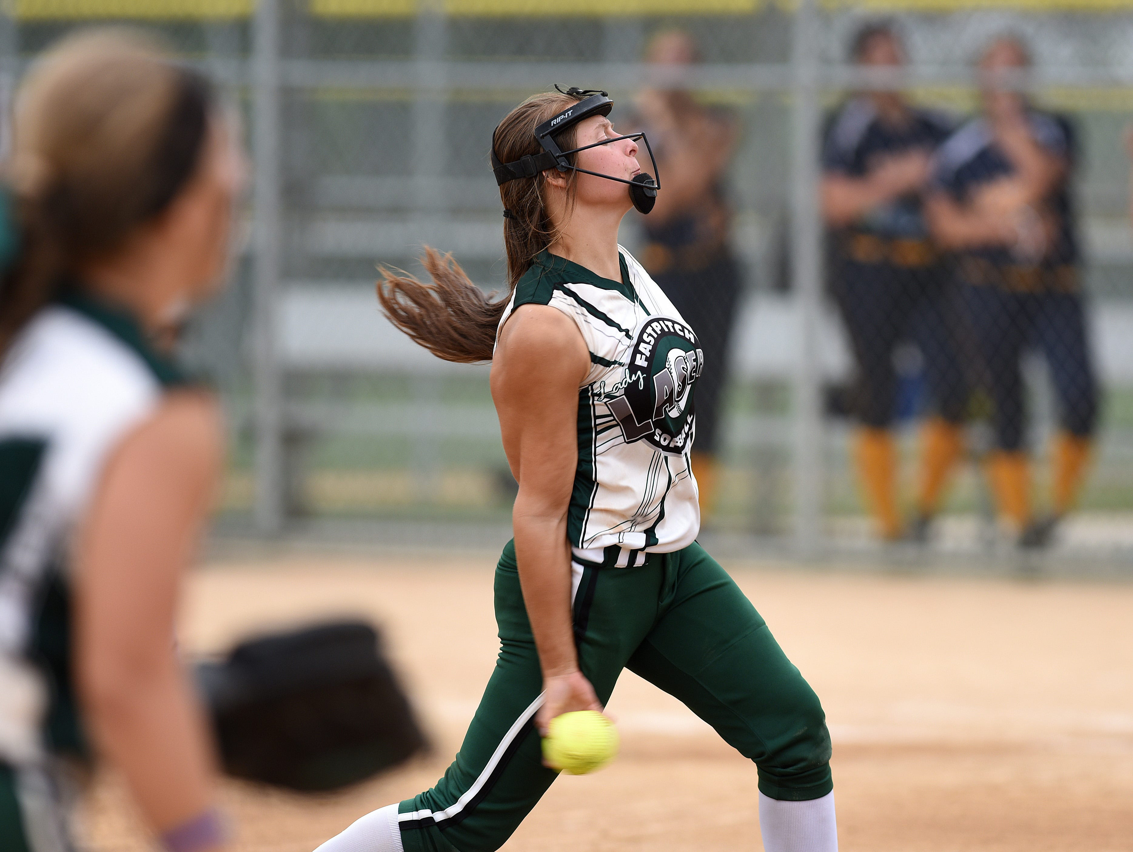 Ohio Lady Lasers Green's #13 Harlie Vannatter pitches against New Lenox Lighting during the ASA 14U national softball tournament at Sherman Park in Sioux Falls, S.D., Monday, Aug. 1, 2016.