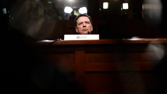 Former FBI Director James Comey testifies during a
