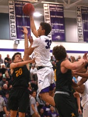 Spanish Springs' Jalen Townsell (32) shoots while taking