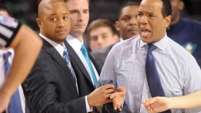 Takayo Siddle (left) is back with UNCW basketball, and as one of two new Black coaches, he sees the diversity strides the school is trying to make.