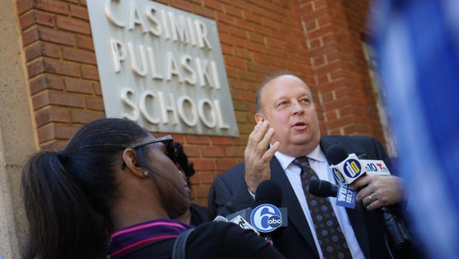 Robert Andrzejewski, acting superintendent for the Christina School District, speaks outside Pulaski Elementary in Wilmington on Friday. Mold was found in three classrooms.