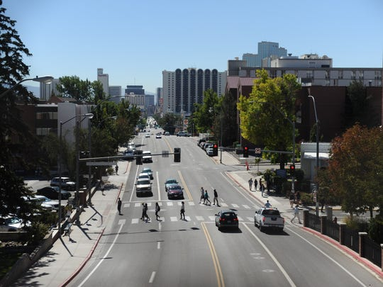 UNR students cross N. Virginia St. Friday morning, Oct. 3, 2014. Downtown Reno is just a few blocks away.