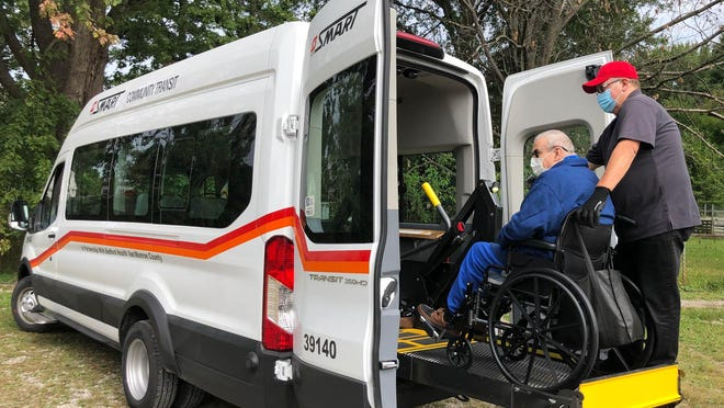 Health Van driver Neil Wiktor provides care and transportation to Raymond Ward coming back from his appointment.