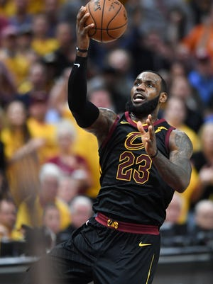 Cleveland Cavaliers forward LeBron James (23) attempts a layup against the Boston Celtics during the third quarter in game four of the Eastern conference finals of the 2018 NBA Playoffs at Quicken Loans Arena.