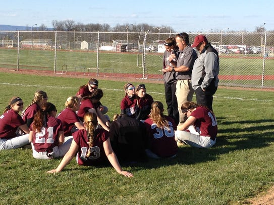 Shippensburg coach Mike Peters, center standing, talks