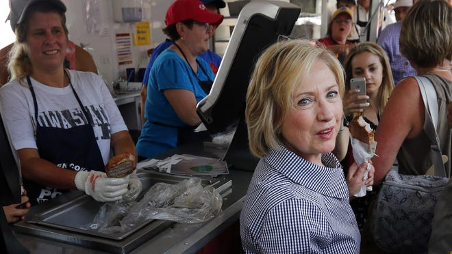 Democratic presidential candidate Hillary Clinton gets a pork chop during a visit to the Iowa State Fair on Saturday in Des Moines.