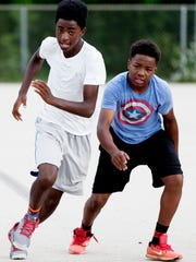 Deandre Hillsman (left) and Kyhli Maxey run during team practice at Meaux Park in Milwaukee.