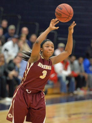 Riverdale's Anastasia Hayes passes to a teammate during the Lady Warriors' 63-52 win over Oakland on Tuesday night.