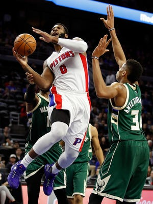 Pistons center Andre Drummond tries to get a shot off next to Bucks forward Giannis Antetokounmpo at the Palace on Dec. 28, 2016. Milwaukee won, 119-94.