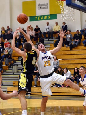 Philo's Lane deal fights for a rebound with Tri-Valley's Dow Cameron during a game last season at The Power Plant. Deal is one of four starters returning to a veteran Electrics team.