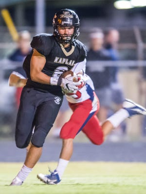 Kaplan High's Logan Roy (6) runs the ball after making a touchdown catch just before halftime in the Pirates' game against the North Vermilion Patriots Thursday Oct. 26, 2017.