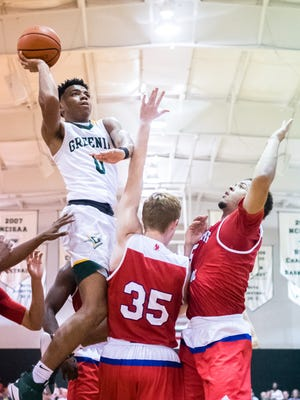 Christ School's Jalen Lecque jumps up for a shot during their game against Spartanburg Tuesday, November 14, 2017.
