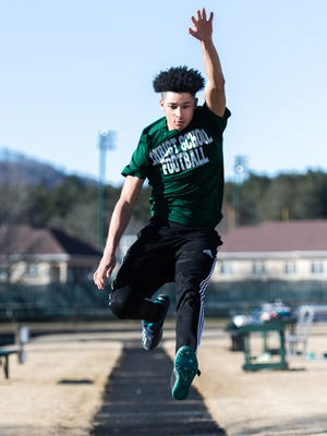 Kevin Snyder, a student at Christ School and a member of the track and field team as a long and triple jumper as well as a runner in the 100 and 200 meter races, warms up before practice Tuesday, January 23, 2018.