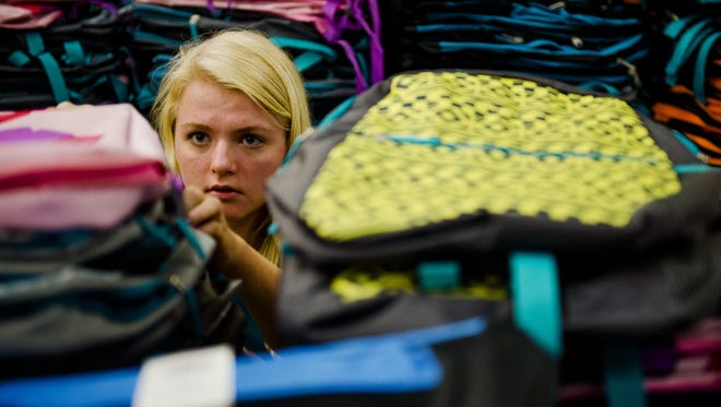 Erin Hull/The Coloradoan Sarah Way counts backpacks with CSU's School is Cool Tuesdayin Fort Collins. The team spent the day organizing school supplies to be packed and delivered to K-12 students in Fort Collins and the surrounding areas. The program estimates it will provide 2,500 backpacks filled with school supplies. Donations can be made at schooliscool.colostate.edu Sarah Way counts backpacks with CSU's School is Cool Tuesday, Aug. 11, 2015, in Fort Collins, CO. The team spent the day organizing school supplies to be packed and delivered to K-12 students in Fort Collins and the surrounding areas. The program estimates it will provide 2,500 backpacks filled with school supplies. Donations can be made at schooliscool.colostate.edu
