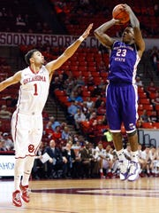 NSU guard Zeek Woodley shoots over Oklahoma's Frank Booker during a Nov. 23 game. Woodley is tied for the nation's scoring lead with 22.8 points per game.