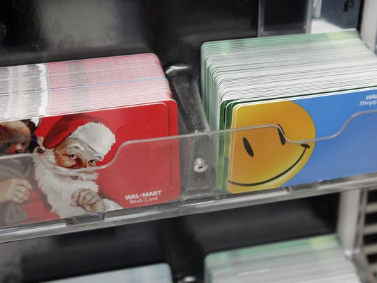 Wal-Mart gift cards are seen on display at a Wal-Mart