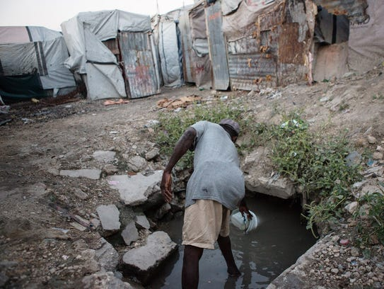 A man collects water on Dec. 11.  Last November, in