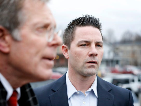 Thomas Clayton looks on as his lawyer, Ray Schlather,