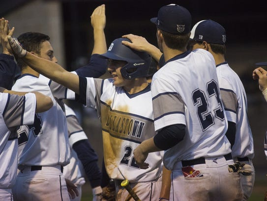 Dallastown's Pete Capobianco, center-left, is congratulated