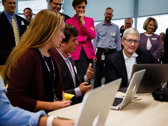 Apple CEO Tim Cook talks with Waukee Apex alum Jacob