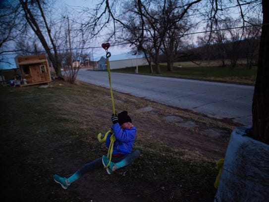 The lack of kids means no playground or other activities in town for Sadi Magnuson, 10, and her three sisters. Instead, their grandfather, Daryl Magnuson, whom they live with, built them their own playground at his home on Wednesday, Dec. 6, 2017, in Carbon.