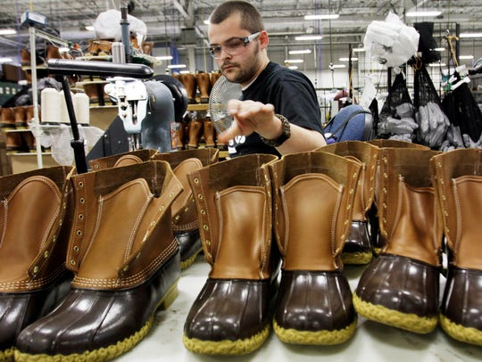 Eric Rego stitches boots in the facility where LL Bean