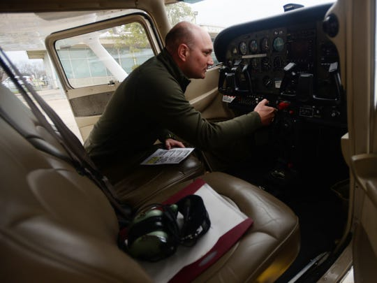 Matt Faulkner checks the plain out before taking flight at Shreveport Downtown Airport.