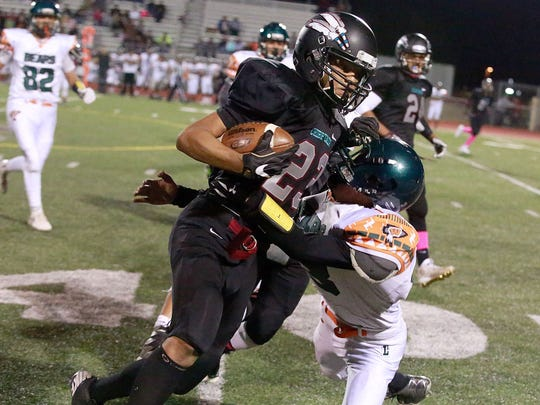 Shiprock's Tyris Newton runs the ball against Wingate on Oct. 21 at Chieftain Stadium in Shiprock.