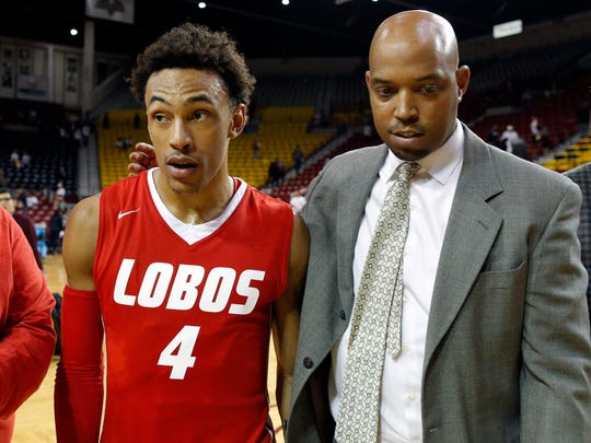 New Mexico assistant coach Terrence Rencher , right, and Lobos guard Eljiah Brown.