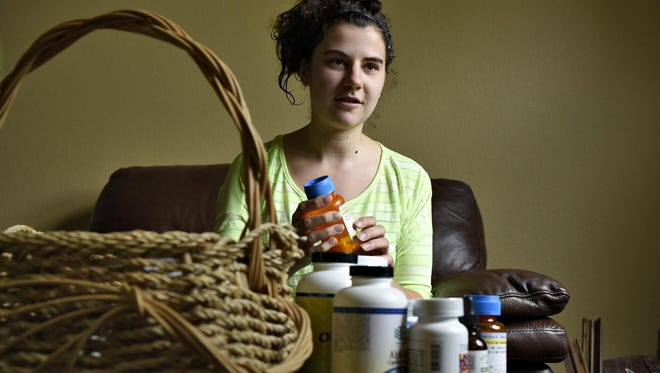 Christin Chandler, 21, talks May 3 about how she handles living with Lyme disease.