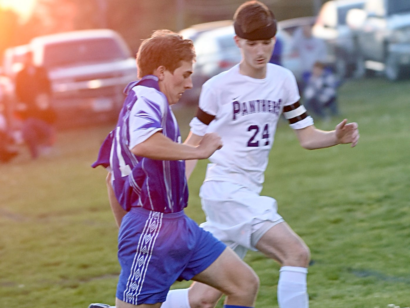 White House High senior Mark Lees dribbles upfield as Portland senior Bryce Stone converges during first-half action.