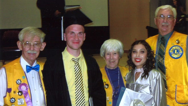 Jared Siddens and Miriah Alonzo graduates at Academy Del Sol on Thursday, May 26, received scholarships from the Alamogordo Breakfast Lions Club to assist with their college expenses at New Mexico State University-Alamogordo. Lion John Douglass, Lion Gerry Douglass and Lion Bob Hein are pictured with Siddens and Alonzo.