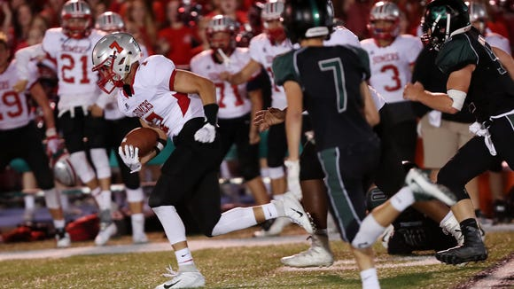Somers defeated Yorktown 35-21 in football action at