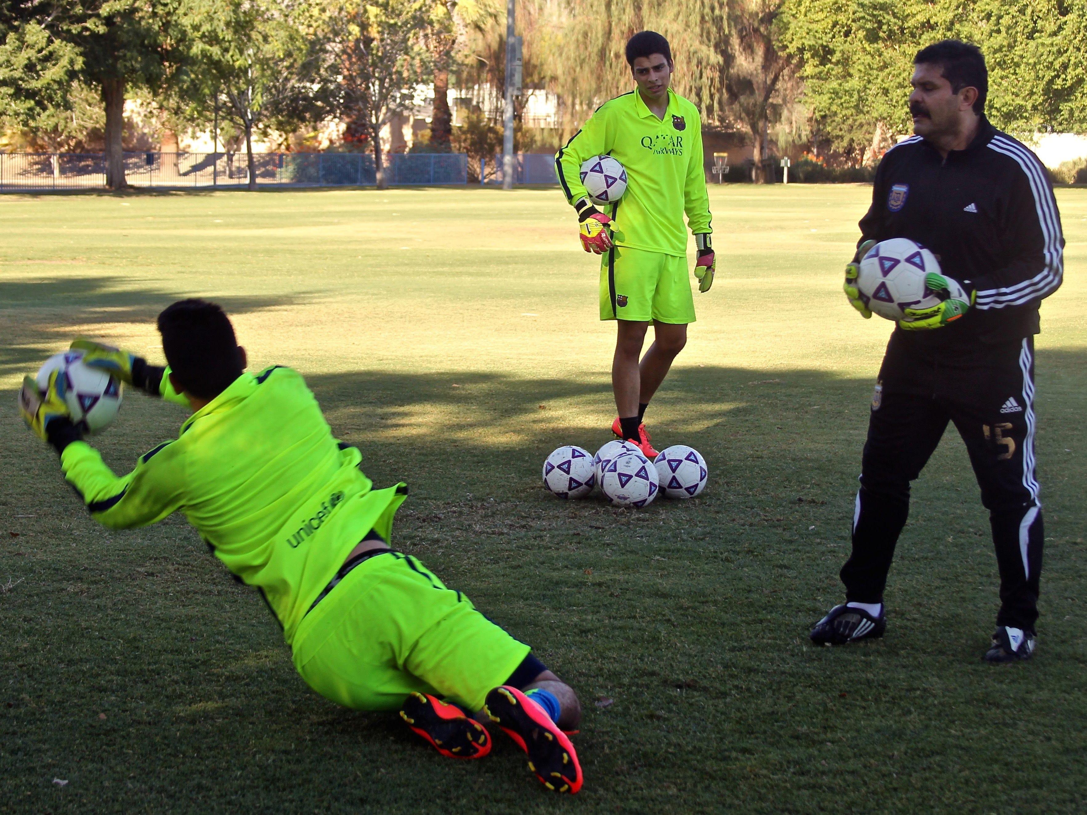 Goalkeeper trainer Carlos Serrato observes Daniel Rivera blocking a kick, Tuesday, at the Hovley Soccer Park in Palm Desert.