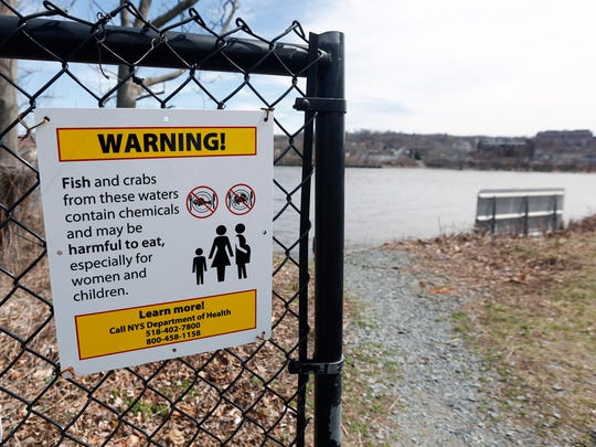 A warning sign hangs on a gate at River Park on April 14 in Green Island. Environmentalists and elected officials are renewing their call for a broader PCB cleanup of the upper-Hudson in what could be the final year of dredging. General Electric is expected to begin its sixth and possibly final season of dredging next month as part of a $2 billion federal Superfund project.