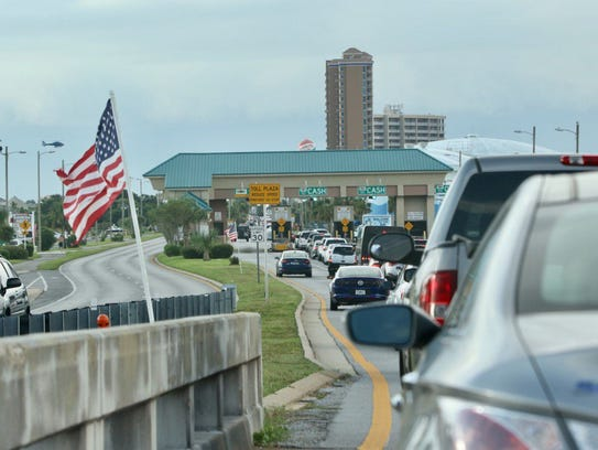 Traffic going over the Bob Sikes Bridge and through