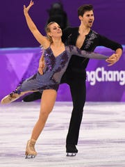 Madison Hubbell and Zachary Donohue (USA) perform in the short dance event.